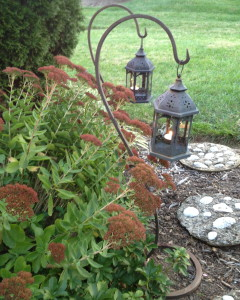 Lanterns on sheppard's hooks are a great portable way of lighting a pathway- or anywhere else!