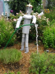 Tin man made from old cans- add a hose, and he becomes a built in helper!
