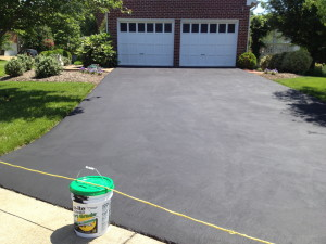 Some earthquake repair and fresh coat of sealer make the driveway look like new!