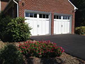 The new garage doors will keep the garage warm enough to double as a greenhouse.