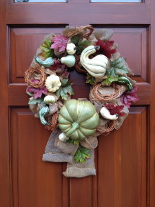 Front and center- adding a seasonal wreath to your front door for a welcoming touch.
