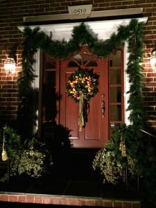The front door at night, with a Williamsburg style this year.