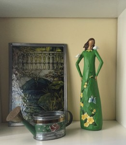 My Earthgirl Statue, handpainted watering can, and a stained glass panel. Love them all!