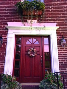 Pink glow on the front door from the setting sun- goodbye summer!